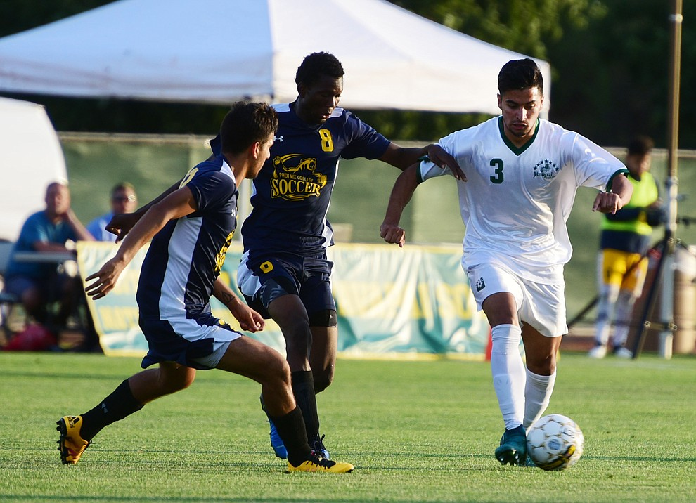 Yavapai's Ziyad Fares brings the ball upfield as the Roughriders take on the Phoenix College Bears Tuesday night at Mountain Valley Park in Prescott Valley. (Les Stukenberg/Courier).