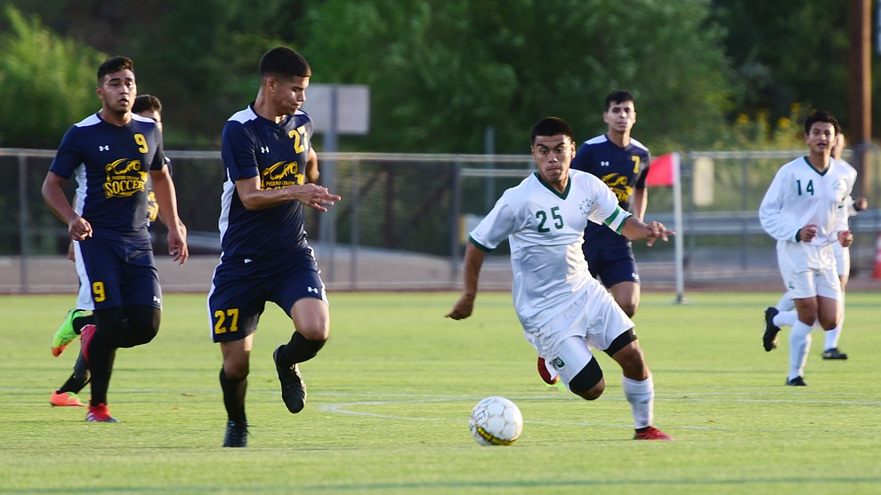 Yavapai's Jose Perez Flores drives the ball forward as the Roughriders take on the Phoenix College Bears Tuesday night at Mountain Valley Park in Prescott Valley. (Les Stukenberg/Courier).