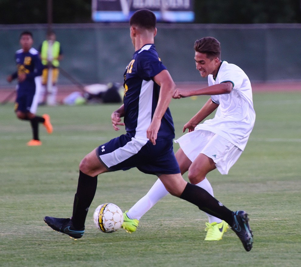 Yavapai's John Searce takes a shot on goal as the Roughriders take on the Phoenix College Bears Tuesday night at Mountain Valley Park in Prescott Valley. (Les Stukenberg/Courier).