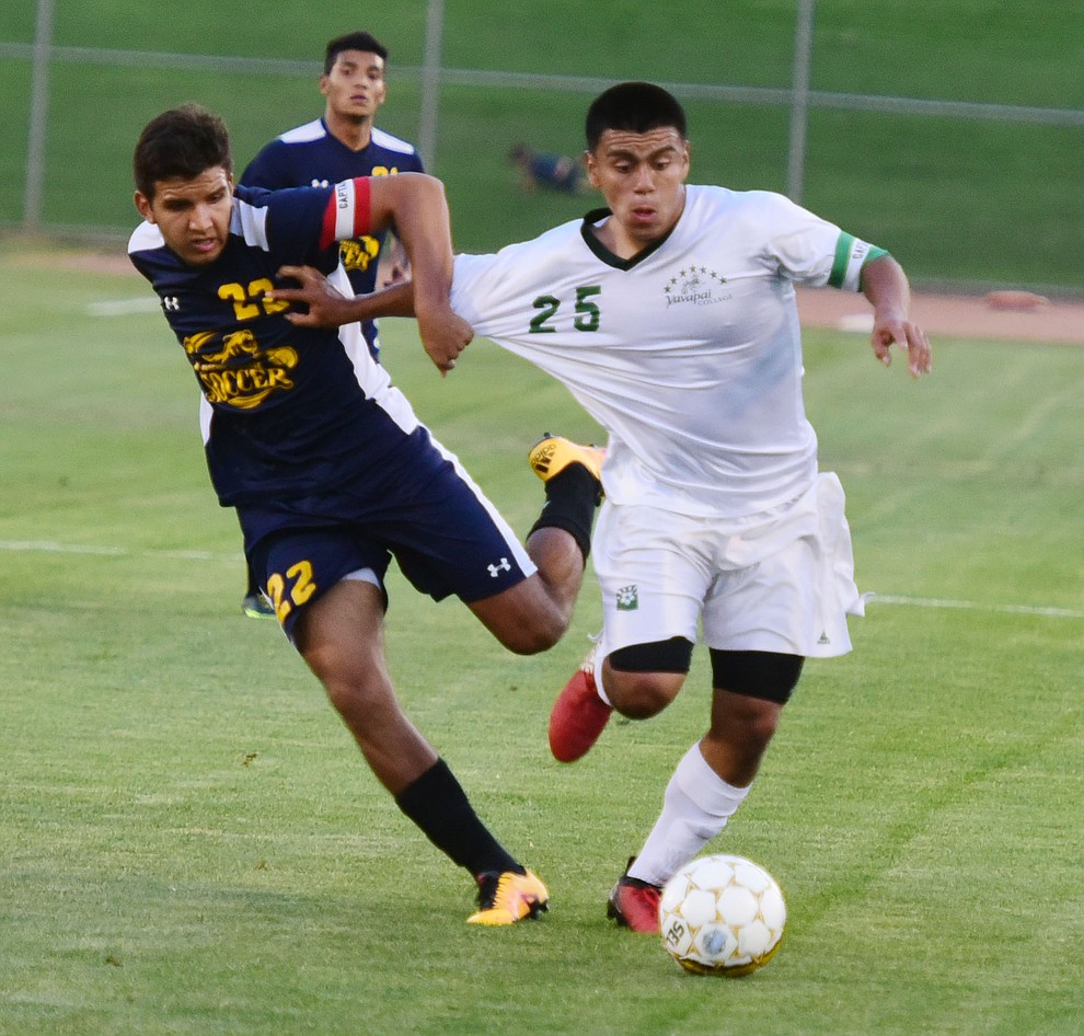 Yavapai's Jose Perez Flores gets held as the Roughriders take on the Phoenix College Bears Tuesday night at Mountain Valley Park in Prescott Valley. (Les Stukenberg/Courier).