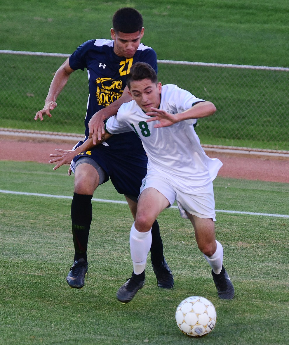 Yavapai's Lorenzo Macias battles on the endline as the Roughriders take on the Phoenix College Bears Tuesday night at Mountain Valley Park in Prescott Valley. (Les Stukenberg/Courier).