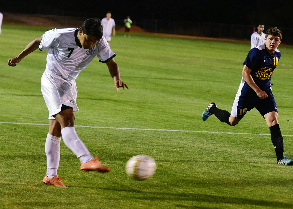 Yavapai's Alexander Guadron scores the lone goal before lighting halted the match as the Roughriders take on the Phoenix College Bears Tuesday night at Mountain Valley Park in Prescott Valley. (Les Stukenberg/Courier).