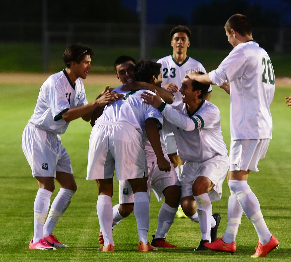 Teammates congratulate Yavapai's Alexander Guadron on his second half goal as the Roughriders take on the Phoenix College Bears Tuesday night at Mountain Valley Park in Prescott Valley. (Les Stukenberg/Courier).