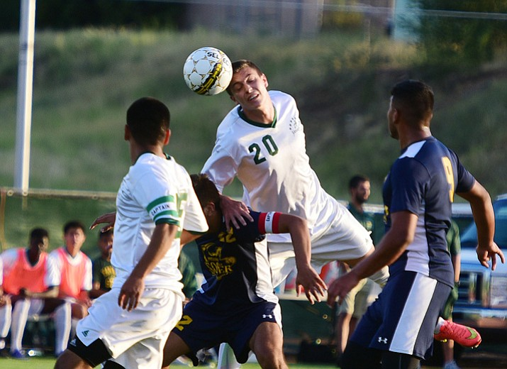 Yavapai College men's soccer player William Baynham heads the bar forward as the Roughriders take on Phoenix College on Tuesday night at Mountain Valley Park in Prescott Valley. (Les Stukenberg/Courier)