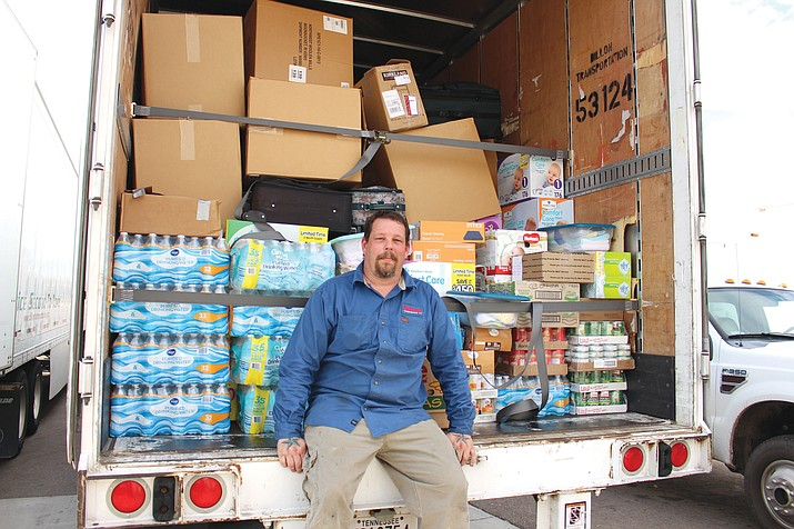 Tim Lamoreaux, maintenance manager for Dillon Transportation at Kingman Airport and Industrial Park, sits on a 53-foot trailer loaded with supplies headed for the Houston area in relief of Hurricane Harvey. The company is sending two trailers from Kingman.