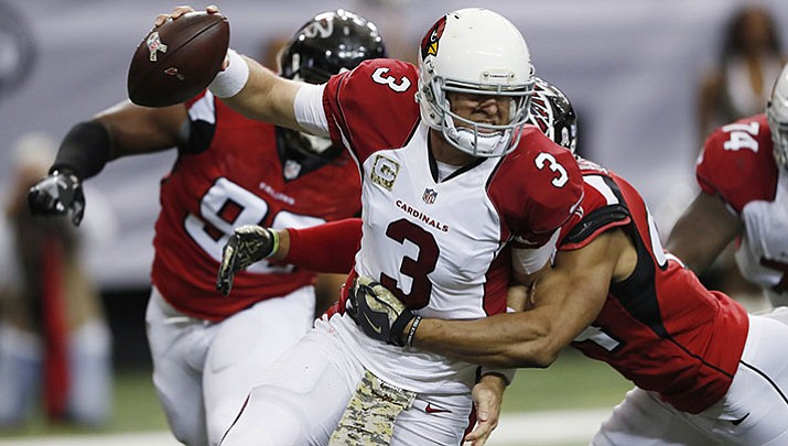 Falcons linebacker Vic Beasley hits Cardinals quarterback Carson Palmer behind the line of scrimmage during a 2016 game in Atlanta. The Cardinals hope to bounce back from a disappointing 7-8-1 season and get back into playoff contention.