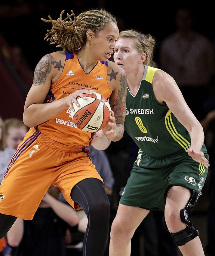 Phoenix Mercury center Brittney Griner spins around Seattle Storm center Carolyn Swords (8) during the first half of a first-round WNBA playoff Wednesday, Sept. 6 , in Tempe.