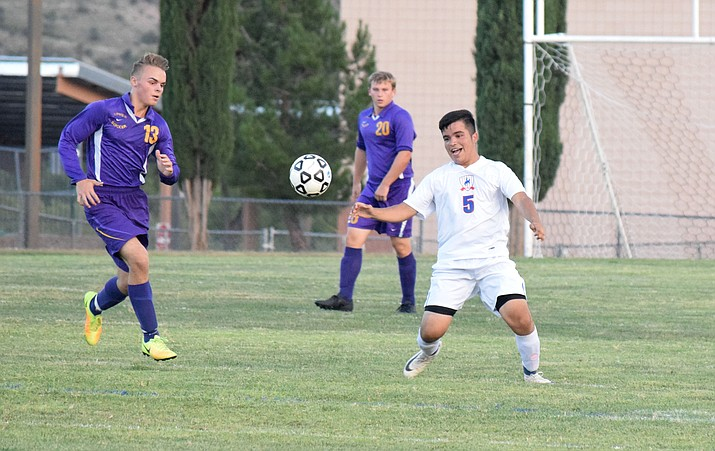 "Camp Verde sophomore Beto Ruiz eyes the ball against Payson. CV head coach David Miller said Ruiz is a ""very committed young man."" (VVN/James Kelley)"