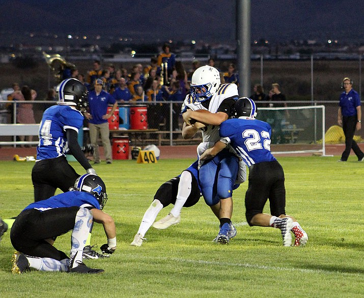Kyle Ferguson and the Kingman High School football team looks to get back in the win column against Page.