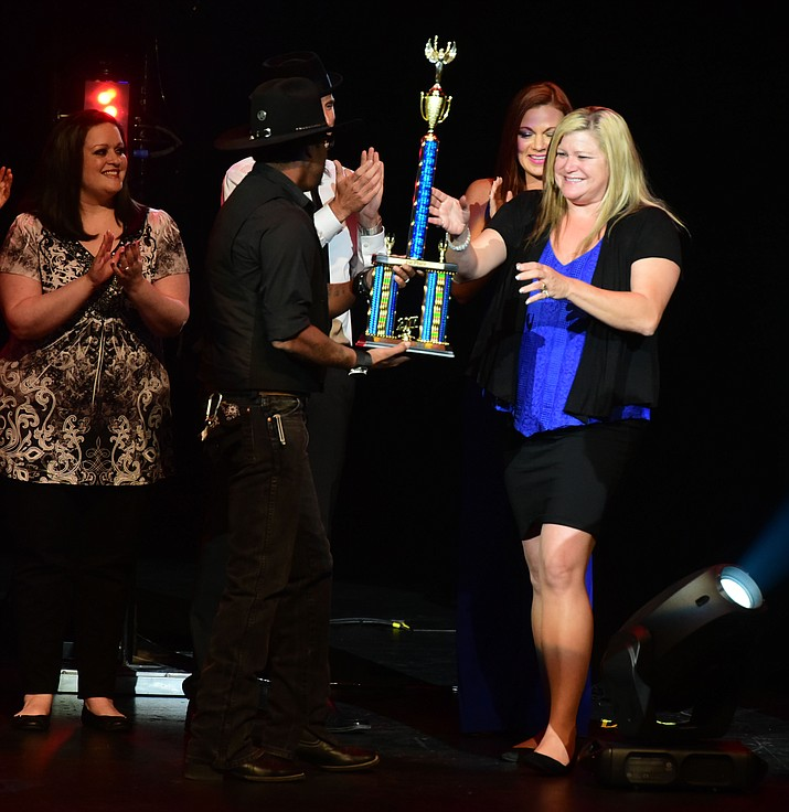 Tiffani Fortney gets the trophy for winning the finale of the 8th annual Prescott Idol competition at the Yavapai College Performance Hall Wednesday, September 6 in Prescott . (Les Stukenberg/Courier).