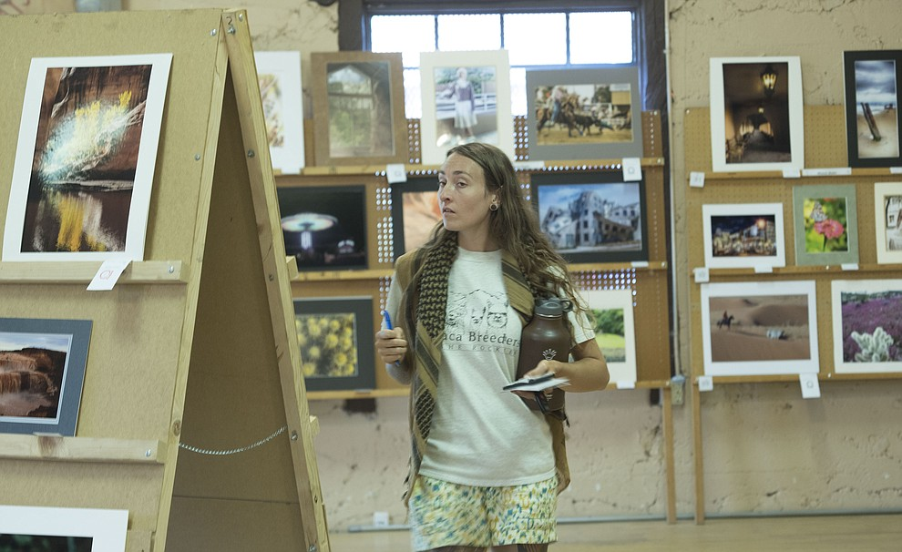 Karissa Barrett looks at the photography exhibit at the 2017 Yavapai County Fair at the Prescott Rodeo Grounds Wednesday, September 7 in Prescott . (Les Stukenberg/Courier).