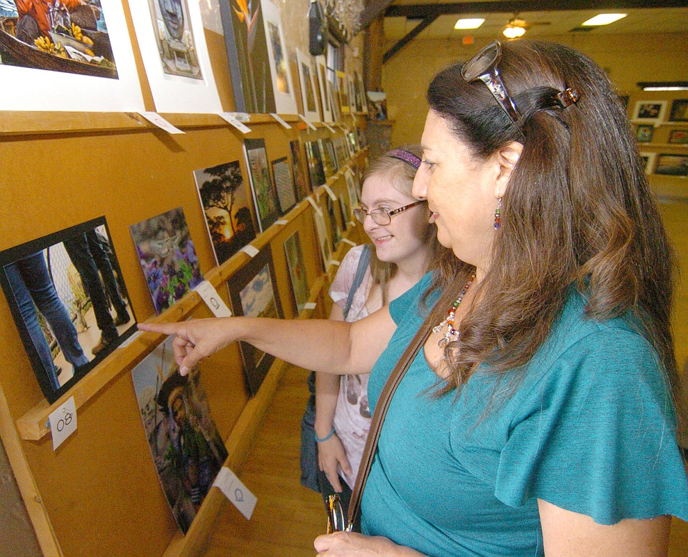Magdalena and Kristie Waidner look at the photography exhibit at the 2017 Yavapai County Fair at the Prescott Rodeo Grounds Wednesday, September 7 in Prescott . (Les Stukenberg/Courier).