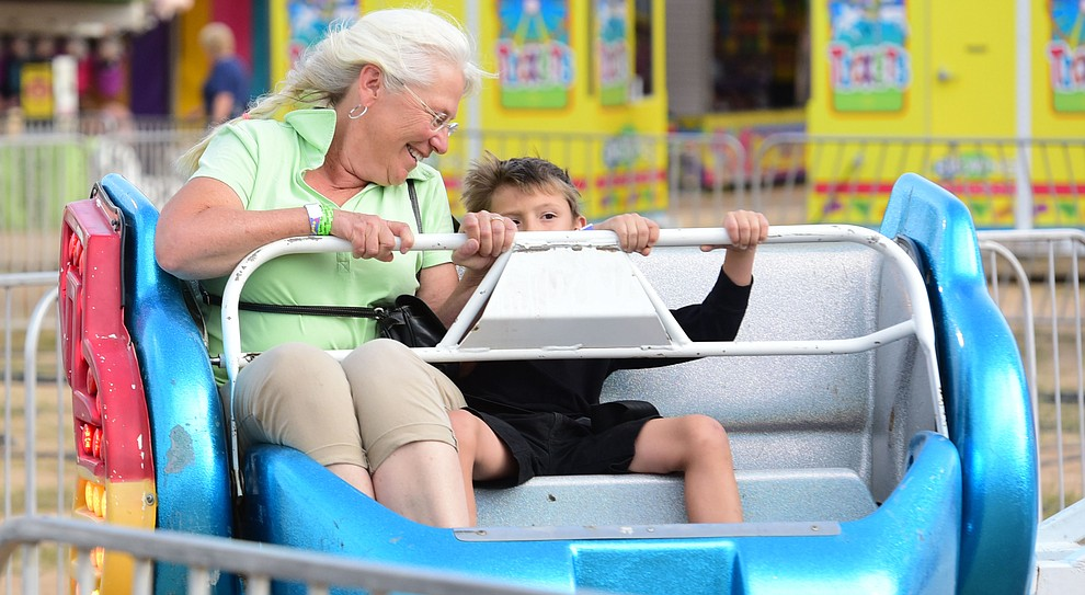Wendy Tilman rides the Sizzler with her grandson Seth at the 2017 Yavapai County Fair at the Prescott Rodeo Grounds Wednesday, September 7 in Prescott . (Les Stukenberg/Courier).