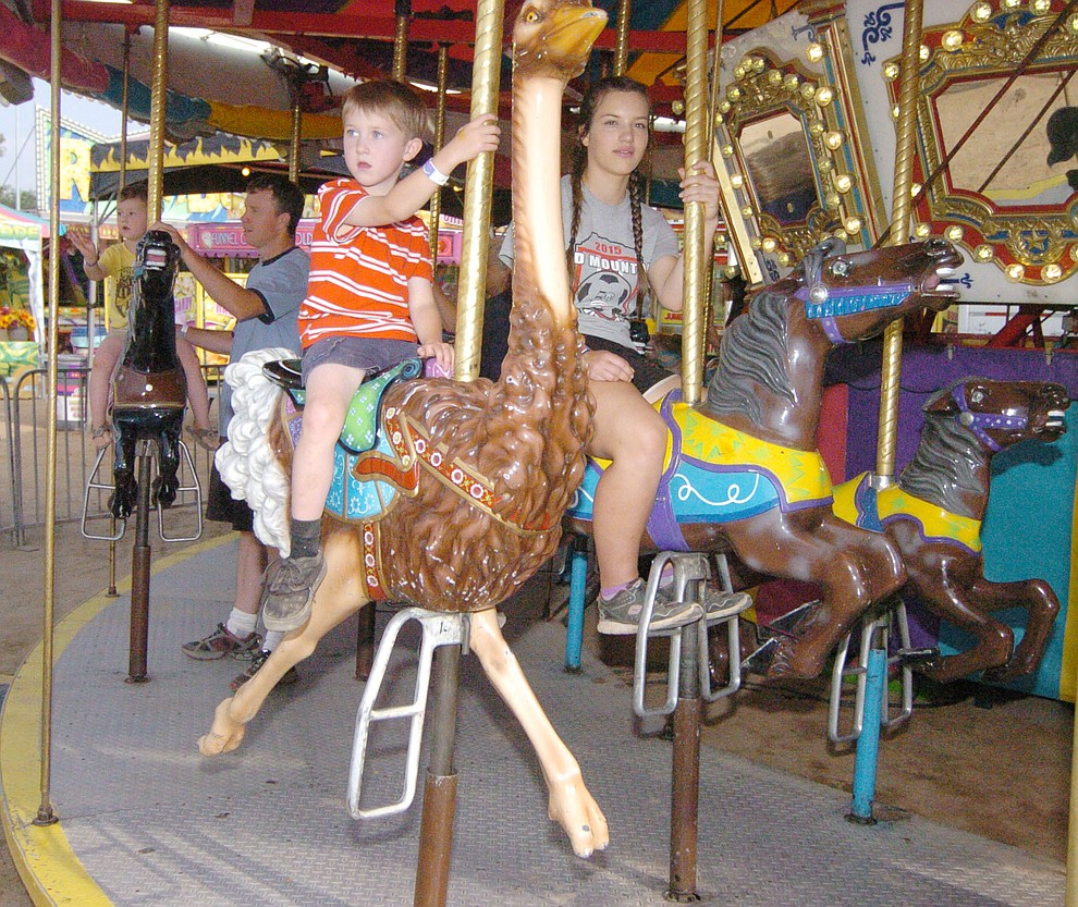 Riding the merry-go-round at the 2017 Yavapai County Fair at the Prescott Rodeo Grounds Wednesday, September 7 in Prescott . (Les Stukenberg/Courier).