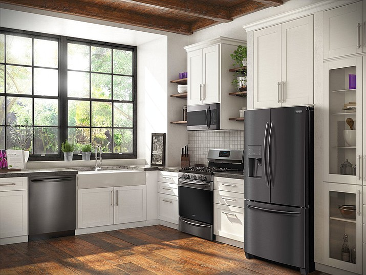 This undated photo provided by Frigidaire shows their new Frigidaire Gallery Smudge-Proof Black Stainless Steel Collection of appliances. Frigidaire offers a suite of appliances in black stainless steel. (Frigidaire via AP)