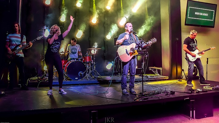 Churches like Central have implemented worship teams (pictured above), bands and social media into sermons.