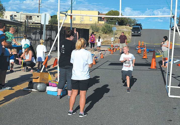 This young boy had a strong finish at the Kids Triathlon Aug. 26. Depending on age, runners had to jog from the Downtown Pool to Spring Street and the Kingman Boys and Girls Club.