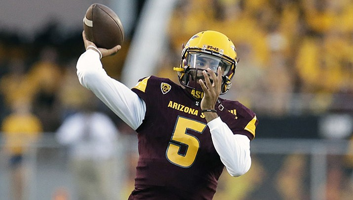 Arizona State Manny Wilkins warms up before the team's NCAA college football game against New Mexico State, Thursday, Aug. 31, 2017, in Tempe, Ariz.