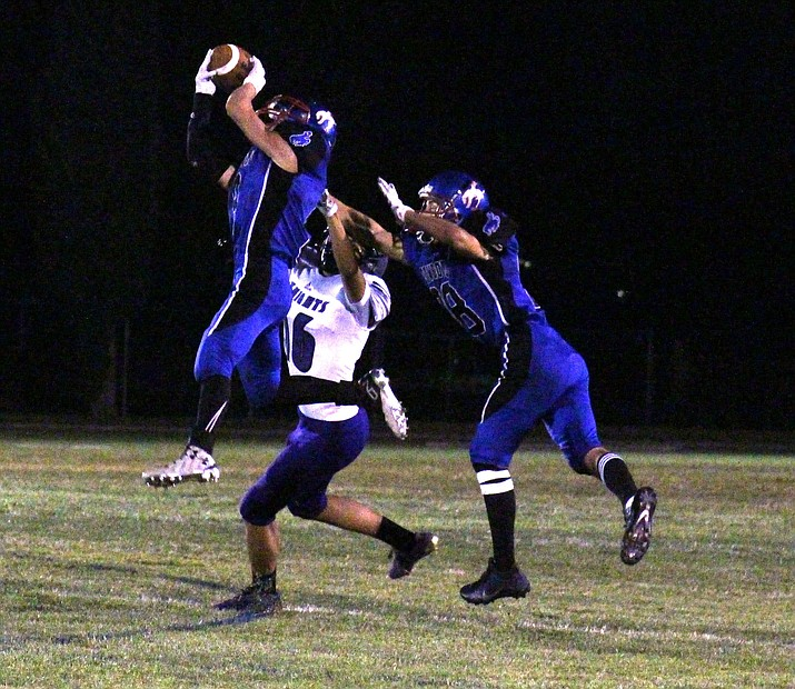 Camp Verde junior Dominiq Bruno intercepts an Arizona College Prep pass during the Cowboys' 22-0 win over the Knights on Friday night. (VVN/James Kelley)