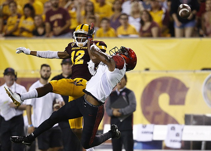 San Diego State's Kameron Kelly, right, breaks up a pass intended for Arizona State's John Humphrey (12) during the first half of an NCAA college football game Saturday, Sept. 9, in Tempe.