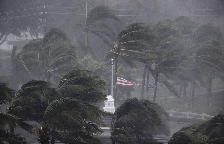 An American flag is torn as Hurricane Irma passes through Naples, Fla., Sunday, Sept. 10, 2017. (David Goldman/AP)