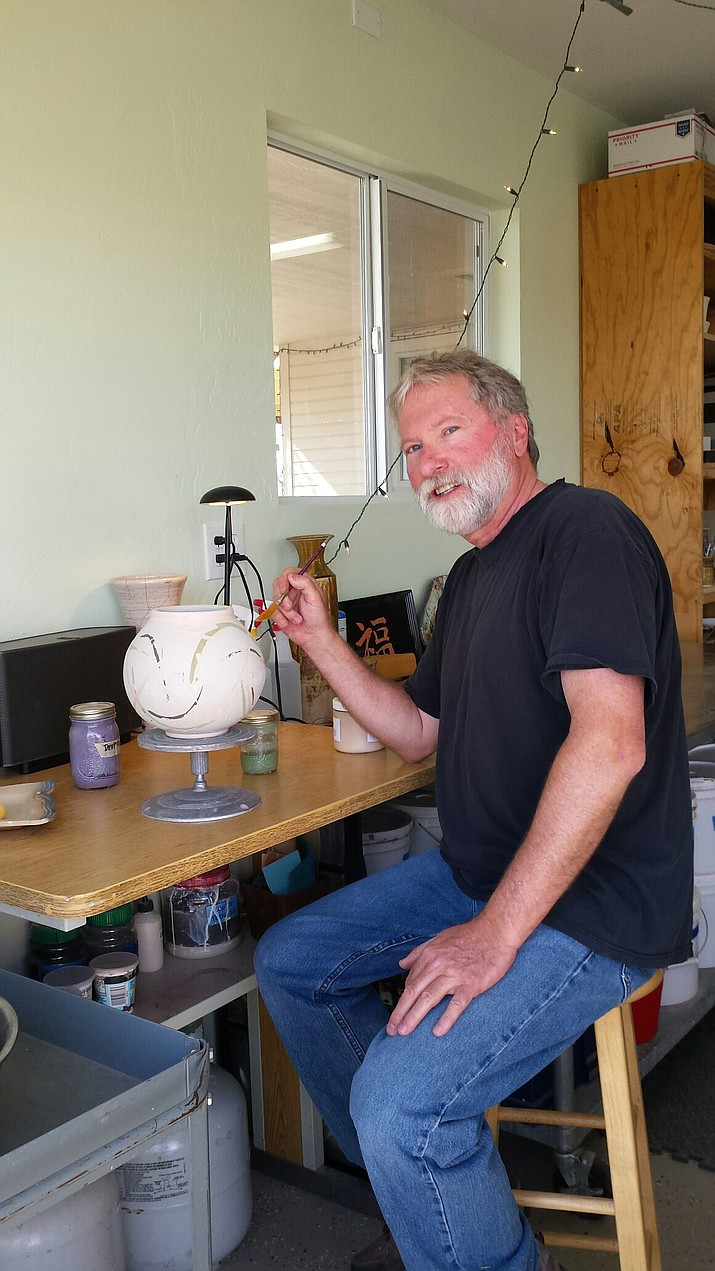 Michael Brown returned to pottery since retiring. He creates functional pottery that is dishwasher- and microwave-safe. (Diane DeHamer/Review)