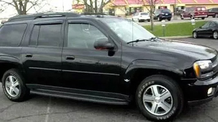 Albuquerque Police say they are searching for a black 2005 Chevy Trailblazer SUV with Oklahoma license plates. This is a photo of an SUV similar to the one that was stolen, not the actual vehicle.