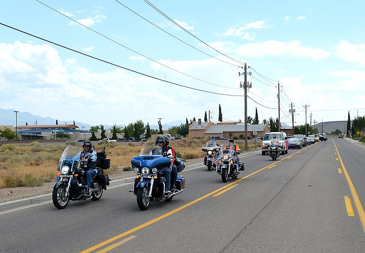 Kingman Patriot Guard Riders escorting the casket (in the van) containing Everett Manakaja Sr., down Western Avenue in Kingman to his final resting place in Peach Springs.