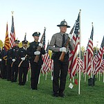 Members of the Honor Guard from five different local agencies post the colors during the Prescott Valley 2017 9/11 Patriot Day Ceremony at the Civic Center in Prescott Valley. (Les Stukenberg/Courier).