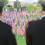 A pair of firefighters look out on the Healing Field during the Prescott Valley 2017 9/11 Patriot Day Ceremony at the Civic Center in Prescott Valley. (Les Stukenberg/Courier).