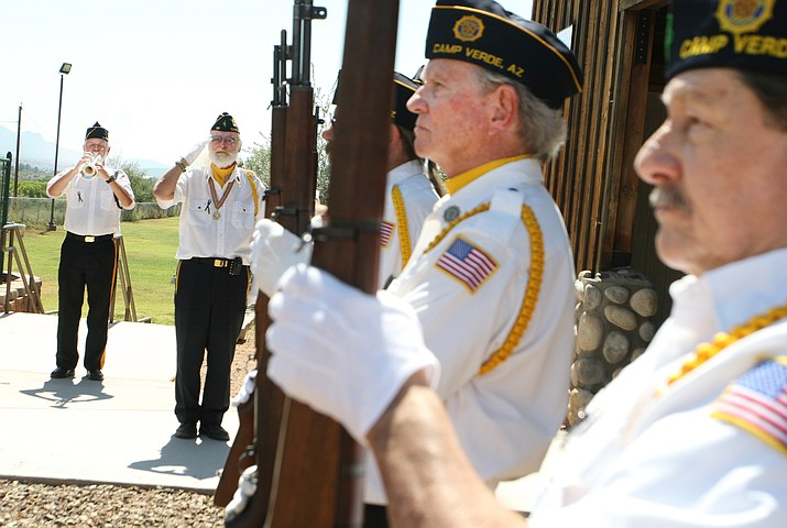 Dr. Ronald Wright of American Legion Post 93 plays Taps during the Legion's Patriot Day remembrance Monday at the Camp Verde Ramada on Hollamon Street. Photo by Bill Helm