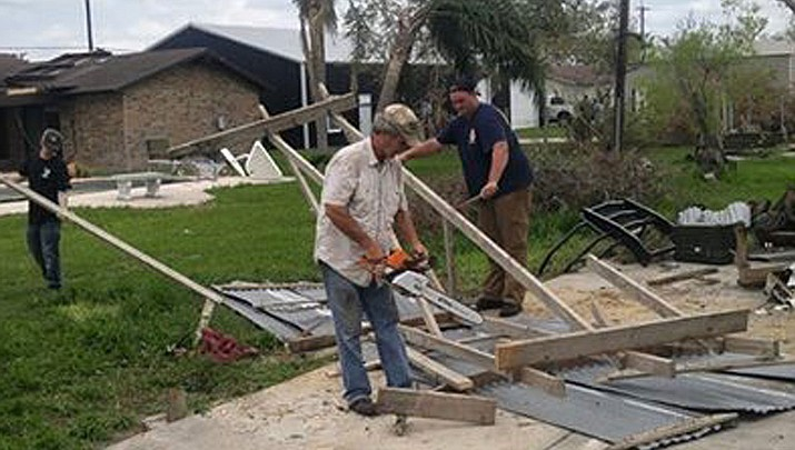 Unidentified volunteers with the Grunt Style team help clean debris from a damaged home in Woodsboro, Texas.