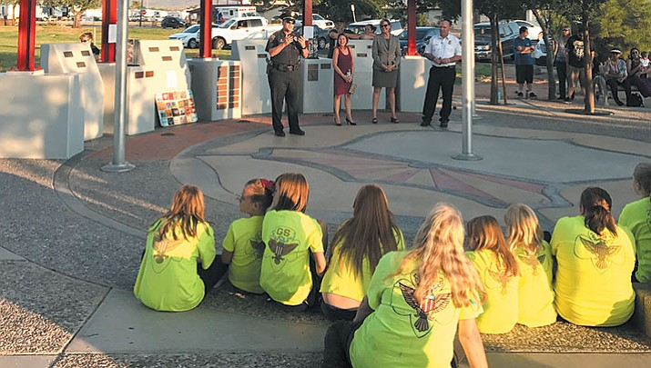 Girl Scouts, Kingman Middle School students and community leaders gather at Firefighter's Memorial Park to remember the events of 9/11 and thank first responders for their service.