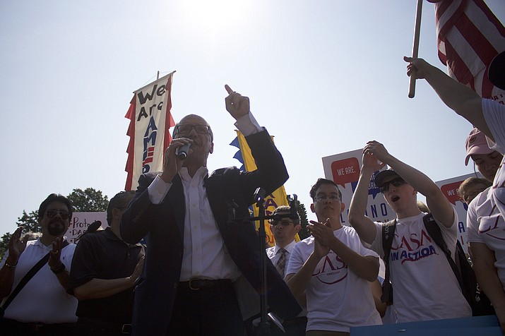"Democratic National Committee Chairman Tom Perez exhorts demonstrators protesting the Trump administration's decision to revoke the DACA program. Perez told the crowd that the party is ""on board"" and ready to fight for a bipartisan legislative solution to reform DACA."