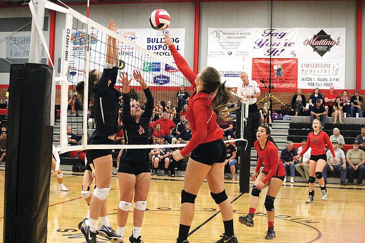 Lee Williams' Tori Logan, right, attempts to send a ball past two defenders Tuesday during a 3-1 loss to Coconino. Logan finished with 15 digs and eight kills.