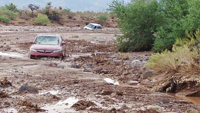 A Honda got caught in a flash flood several years ago in the Sacramento Wash. FEMA has removed 3,200 parcels of land in Mohave County from its high hazard list.