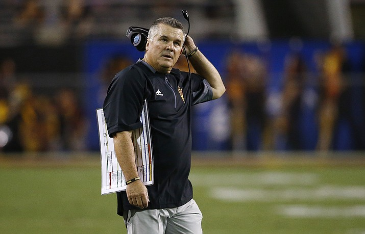Arizona State coach Todd Graham stands on the field during the first half against San Diego State on Saturday, Sept. 9, 2017, in Tempe. (Ross D. Franklin/AP)