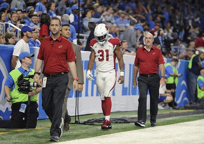 Arizona Cardinals running back David Johnson (31) walks off the field with medical staff for X-rays Sunday, Sept. 10, 2017, in Detroit. (Jose Juarez/AP)