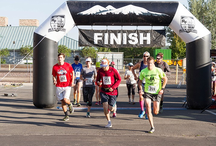 Runners cross the line at the Mountain Man Run in downtown Williams.