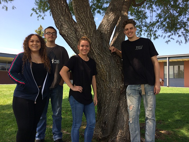 Prescott High School seniors Elena Aragon, Bradley Stalnaker (rear), Kirsten Hillig (center) and Kody Jones (far right) in the high school courtyard. (Nanci Hutson/Courier)