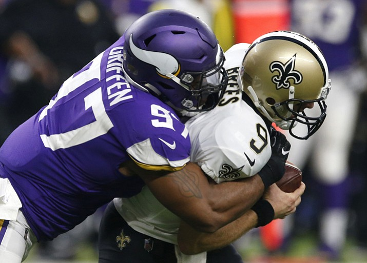 New Orleans Saints quarterback Drew Brees (9) is sacked by Minnesota Vikings defensive end Everson Griffen (97) during the first half Monday, Sept. 11, 2017, in Minneapolis. (Jim Mone/AP)
