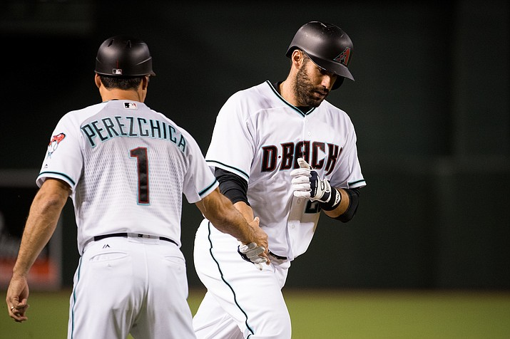 J.D. Martinez is greeted by Arizona Diamondbacks third base coach Tony Perezchica after hitting his 38th home run overall and 22nd for the D-backs this season in Arizona's 4-2 loss Tuesday.