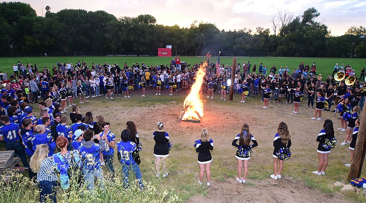 Students gather for the bonfire during the annual Prescott High School Homecoming Parade and Bonfire Wednesday, September 13 at Prescott Mile High Middle School. (Les Stukenberg/Courier).