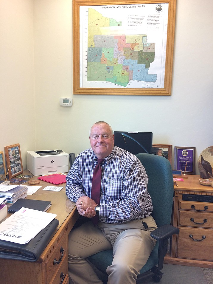 Arizona Board of Education President Tim Carter, the Yavapai County Schools superintendent, sits at his desk at the Yavapai Education Service Agency. (Nanci Hutson/Courier)
