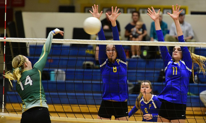 Prescott volleyball players Danielle Dreher (8) and Savanna James (11) go for a block as they host Mohave in their Grand Canyon region opener Tuesday, Sept. 12, 2017, in Prescott. (Les Stukenberg/Courier)