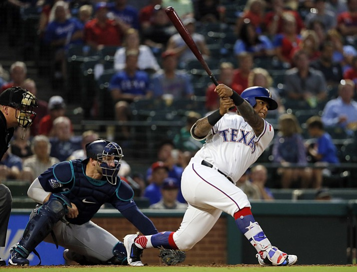 Texas Rangers' Willie Calhoun follows through on an RBI single off Seattle Mariners' Marco Gonzales during the second inning Tuesday, Sept. 12, 2017, in Arlington, Texas. The hit for Calhoun, a former Yavapai College baseball standout, is his first in the majors. (Tony Gutierrez/AP)