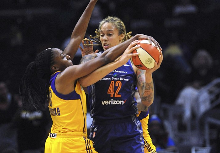 Los Angeles Sparks forward Nneka Ogwumike (30) tries to get the ball from Phoenix Mercury's Brittney Griner (42) during the first half of a playoff game Tuesday, Sept. 12, 2017, in Los Angeles. (Stephen Carr/Los Angeles Daily News via AP)
