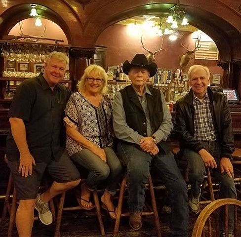 From left, Larry Wilcox (who played Jon on the TV show CHIPS), Kitty and Frank Shankwitz, and Robert Pine, pose at the Palace Restaurant and Saloon on Whiskey Row in Prescott. (Frank Shankwitz/Courtesy)