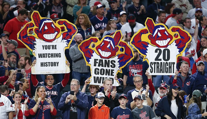 Cleveland Indians fans celebrate a 2-0 victory over the Detroit Tigers in a baseball game, Tuesday, Sept. 12, 2017, in Cleveland. The Indians won their 20th game in a row, tying the American League record. (AP Photo/Ron Schwane)