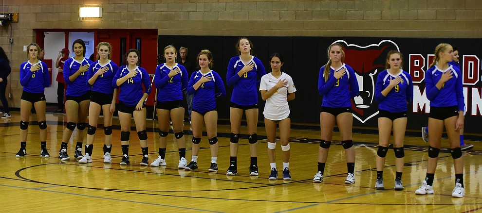 Prescott players stand for the National Anthem as Bradshaw Mountain hosted cross-town rival Prescott in a volleyball matchup Thursday, September 14 in Prescott Valley. (Les Stukenberg/Courier).